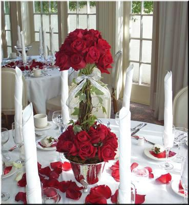 One Christmas wedding I went to used Christmas poinsettas as centerpieces