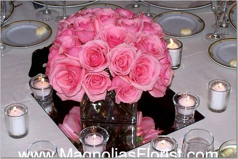Re Centerpiecesthink I want lowlying red and pink roses surrounded by